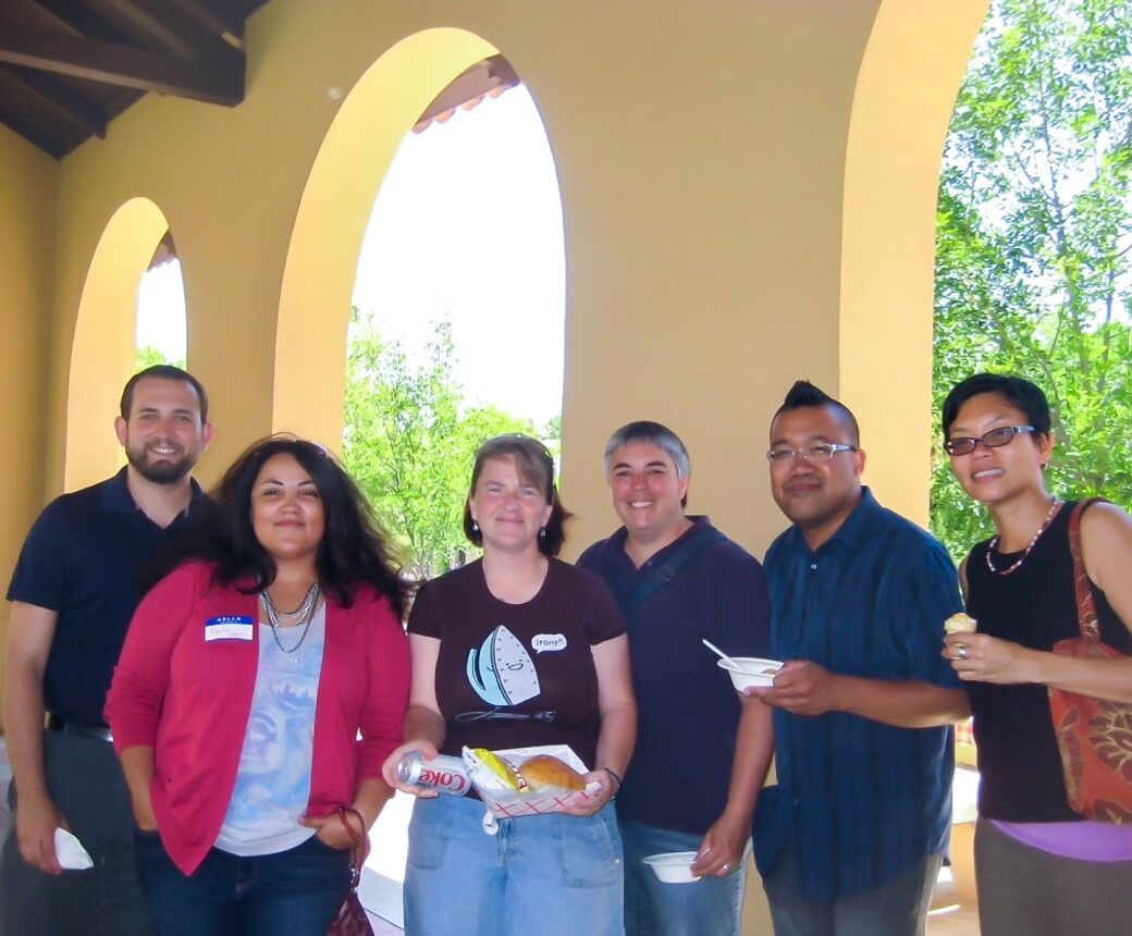 Group shot of the Queer University Employees at Stanford (QUEST)