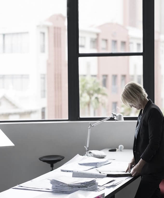 Woman working at desk while standing