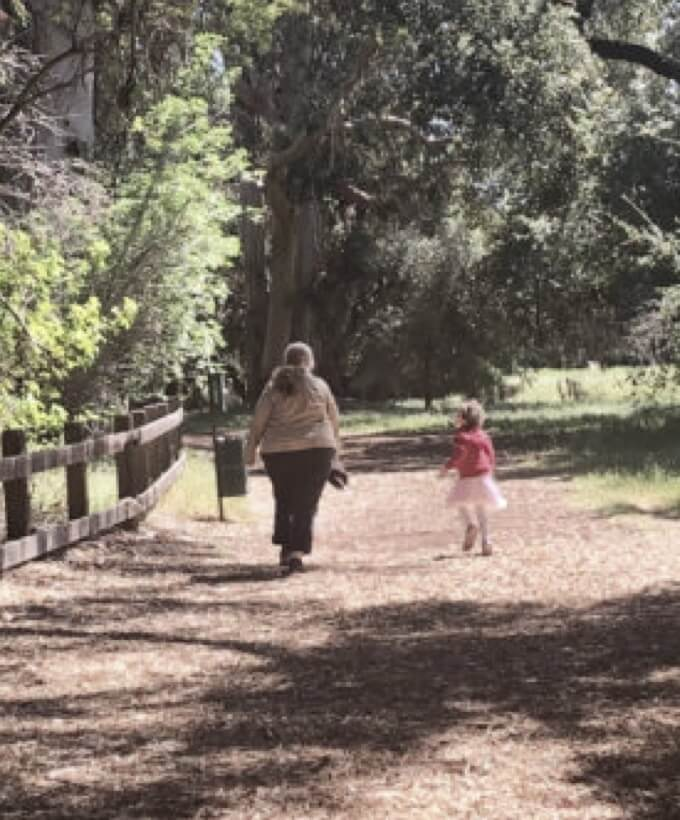 Woman walking on trail with child